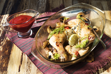 sause: Roasted chicken legs with mushrooms and sause