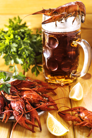 Boiled crawfish with lemon and beer