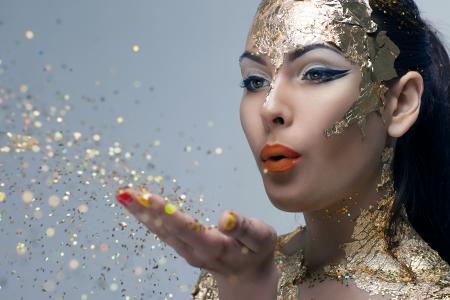 girl blows the palms confetti