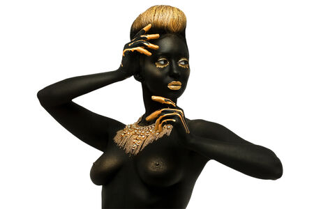 dark-skinned woman with golden visage and decoration on the chest