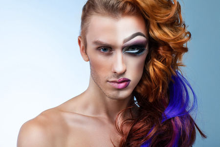 portrait of a man with a womans make-up half-face