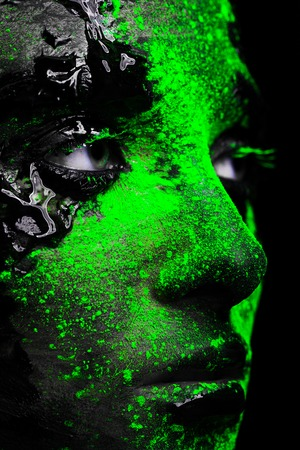 face covered: close-up of a womans face covered with paint