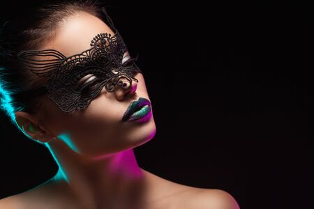 mystery woman: a mysterious stranger in a beautiful mask on a black background