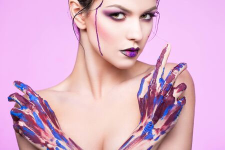 color model: and beautiful young girl with paint on body and hands