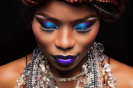 dark skin: large frame female face with dark skin and bright makeup