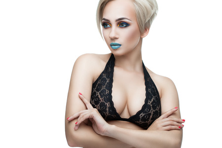 tetona: busty blonde in a black top and evening make-up on a white background