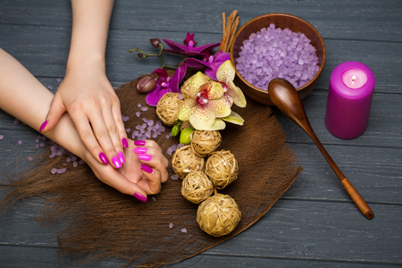 sea salt and orchid in the spa salon for the womens hands Stock Photo