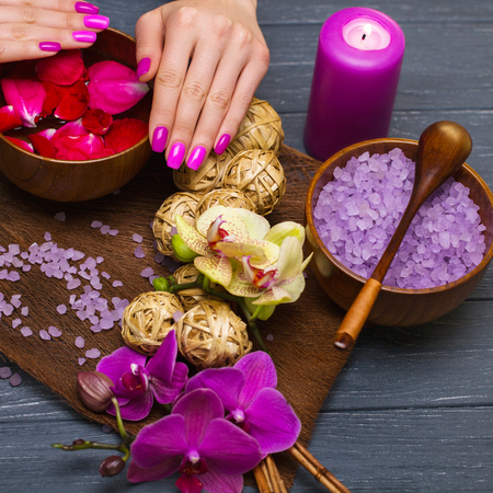 health concern: sea salt and orchid in the spa salon for the womens hands Stock Photo