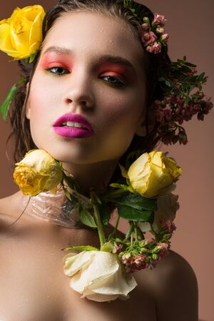 virginity: fading bouquet of flowers around the face of a young girl Stock Photo