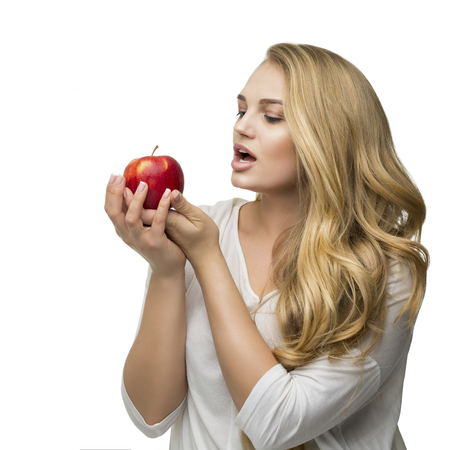 beautiful blonde chooses the right food, apples are vitamins