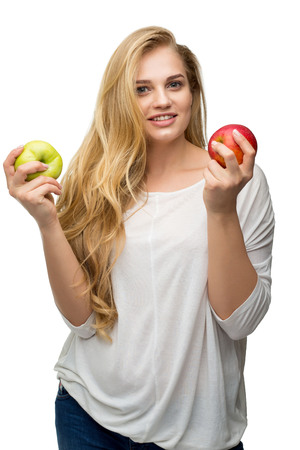 problem of slimming and proper nutrition, beautiful blonde with apples on a white background