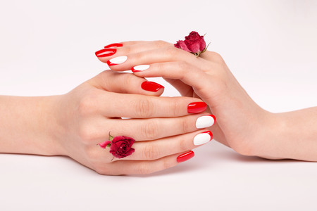 well-groomed womens hands with red lacquer, perfection in small things Stock Photo