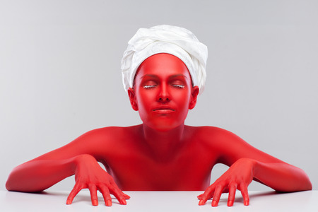 Stock Photo   Young Girl Painted Red, Little Devil In The Kitchen
