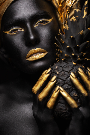 black woman with black pineapple in her hands, gorgeous image of black and zloty