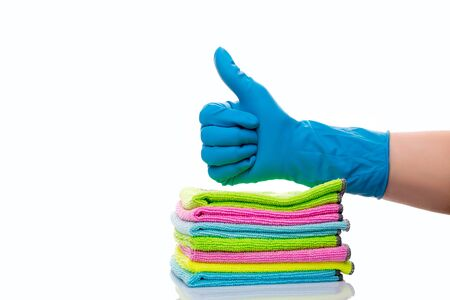 approval of the selected material for cleaning, hands in blue gloves