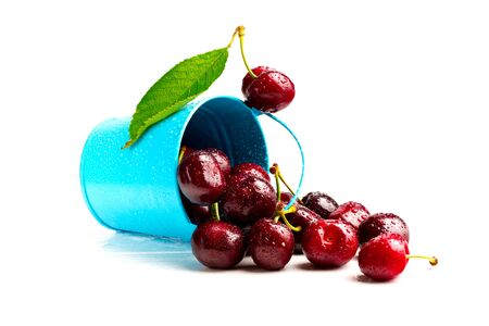 a bucket of cherries on a white background, ripe summer berry Reklamní fotografie