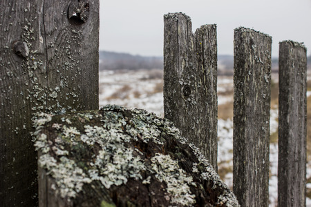 misery: The old fence in a Russian village Stock Photo