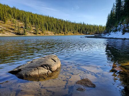 Scenic views of Alberta, Canada. Rocky Mountain foothills and peaks. Allstones Lake. October