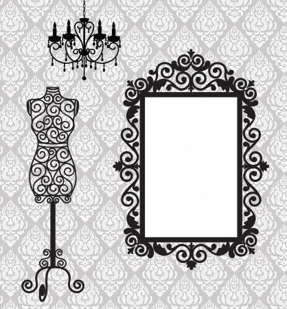 fashion boutique: Antique frame, mannequin and chandelier