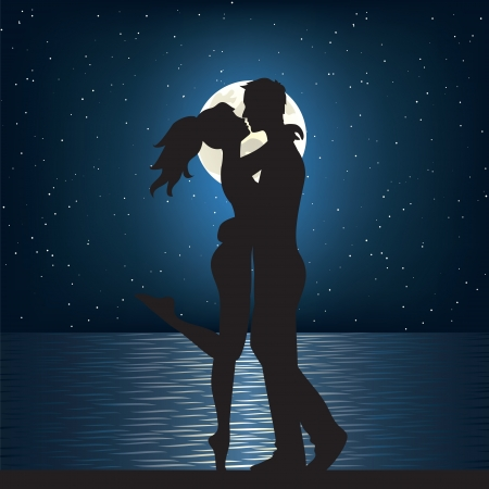 Man and woman kissing on the sea at night