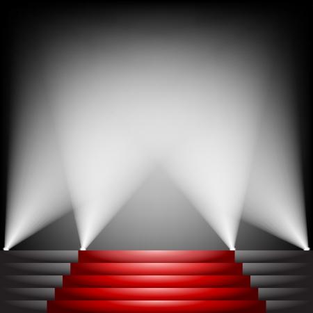 Rood tapijt en trappen met schijnwerper omhoog