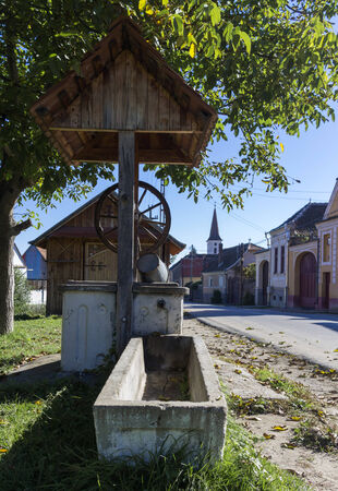 Rural well in the romanian traditional village photo