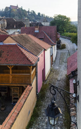 Street of ancient medieval town Sighisoara, Romania photo