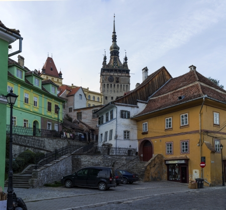 Clock Tower and street of medieval town Sighisoara, Romania photo