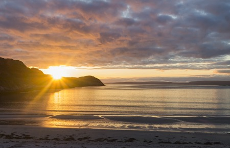 bight: Sand beach and sunset on the Barents Sea, Norway Stock Photo