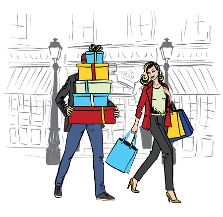 woman walk: woman with shopping bags and man with boxes walking on boutique street