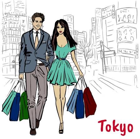 Frau und Mann mit Einkaufstüten zu Fuß auf der Straße in Shibuya, Tokio, Japan