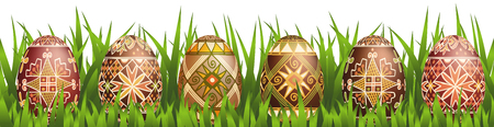 Pysanky easter eggs in grass isolated on white. Traditional ukrainian easter eggs.