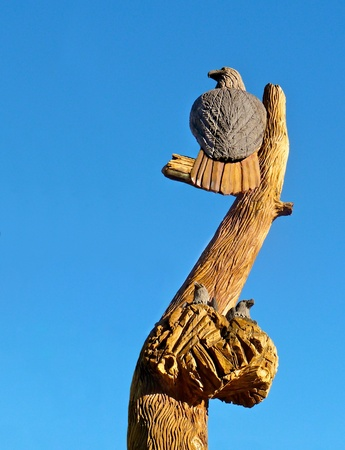 Carved out of wood, this sculpture represents an eagle and its nest with not so little chicks. Squaw Valley, CA
