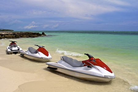 water jet: Jet Ski waiting at the shore on a tropical beach