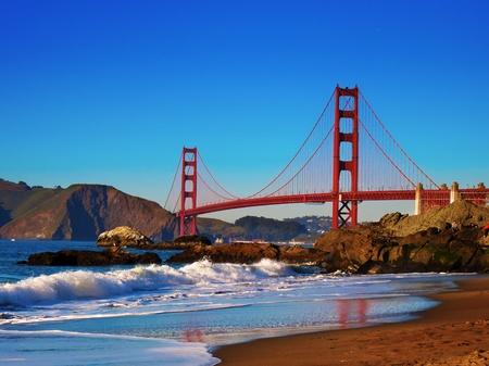 Golden Gate Bridge view from Baker Beach just before sunset.  Фото со стока