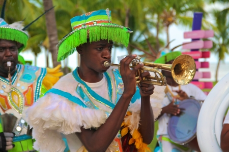freeport: Male dancers dressed in traditional costumes performing at a Junkanoo festival playing a trumpet Editorial