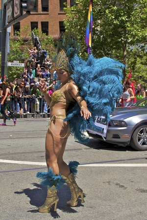 Gay Pride Participant In Colorful Costume With Feathers - Editorial
