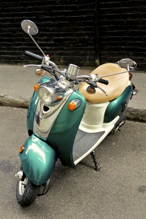 Old green and white Vespa Venice Scooter Editorial