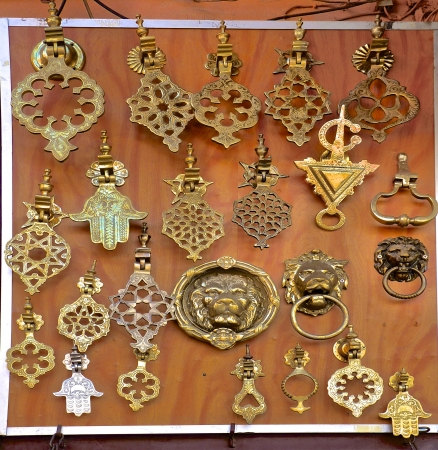 Intricate ornate handmade metal door knockers at a moroccan souk in Marrakech photo