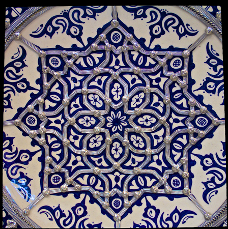 Traditional Moroccan embellished plate decorated with ornate silver filigree photo