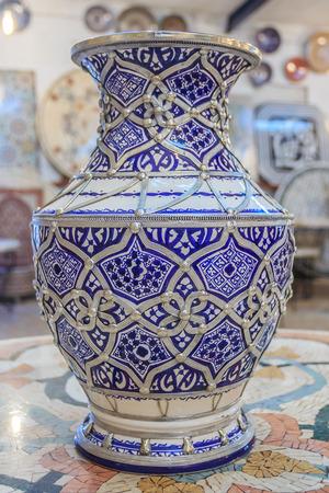 embellished: Traditional Moroccan embellished vase decorated with ornate silver filigree