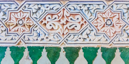 fes: Decorative alabaster wall carvings in a riad in Fes, Morocco