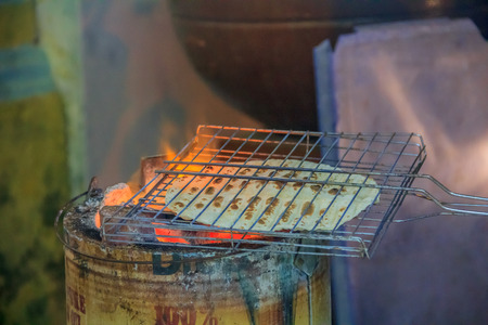 Indian flat bread roasted in the street of Georgetown Penang Malaysia. Penang is a well known street food capital of South East Asia