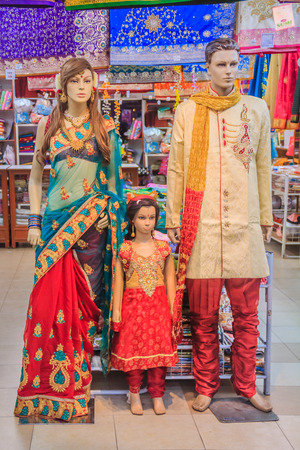 sari: Mannequin family dressed in traditional Indian colorful clothing at the sari street market in Penang Malaysia