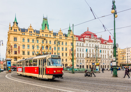gothic architecture: PRAGUE,CZECH REPUBLIC - January 15,2015: One of the symbol of Prague; a tram - street car turning in Old Town Star Msto by Nmst Republiky station