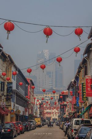 unearthly: Singapore, Singapore - June 16, 2013: Famous Chinatown in Singapore with colonial houses. Smog in the air is caused by the burning of palm plantations in Indonesia