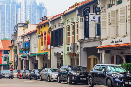 unearthly: Singapore, Singapore - June 16, 2013: Famous Club street in Singapore with colonial houses. Smog in the air is caused by the burning of palm plantations in Indonesia