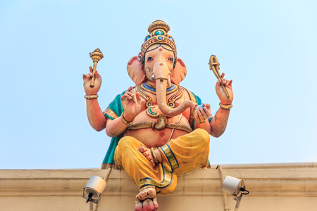 divali: Sculpture of Ganesh Ganesha elephant god on the roof of the Sri Mariamman hindu temple in Singapore