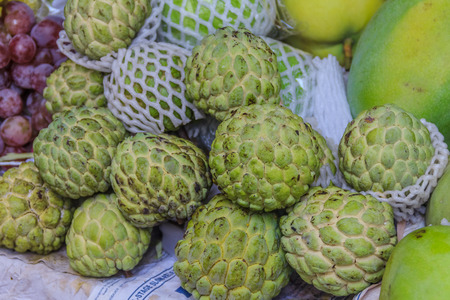 chirimoya: Cherimoya fruit or custard apple at the market in Xiamen, China. The fruit is belived to have anti cancer powers