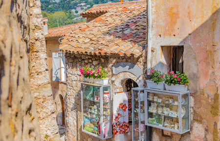 french ethnicity: Old buildings and narrow streets in the picturesque medieval city of Eze Village in the South of France along the Mediterranean Sea